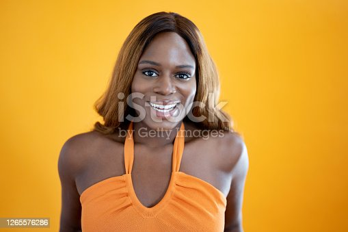 istock Portrait of relaxed young black woman with long brown hair 1265576286