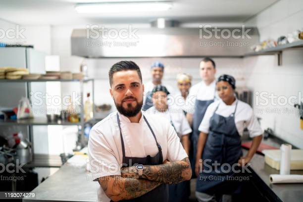 Portrait of restaurant chef with his team in the kitchen picture id1193074279?b=1&k=6&m=1193074279&s=612x612&h=jbud0p6xgpp3oweps06cv5lb8x04mtocfpyajnh9ro0=