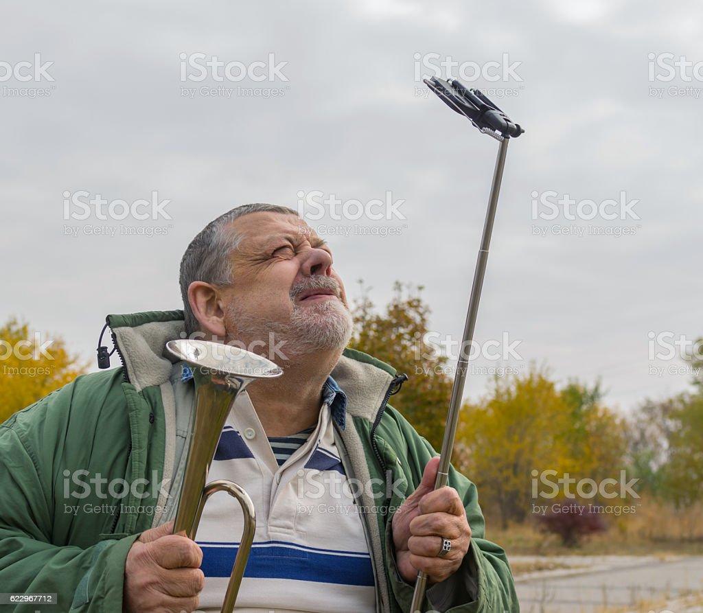 Portrait of ridiculous senior man making faces stock photo