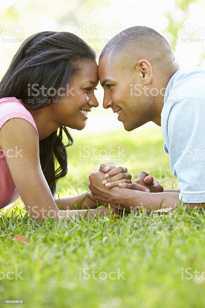 Portrait Of Romantic Young African American Couple In Park stock photo