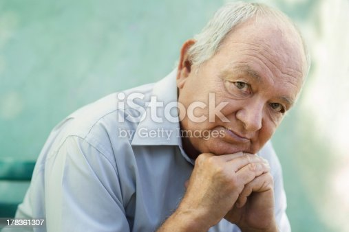 istock Portrait of sad bald senior man looking at camera 178361307
