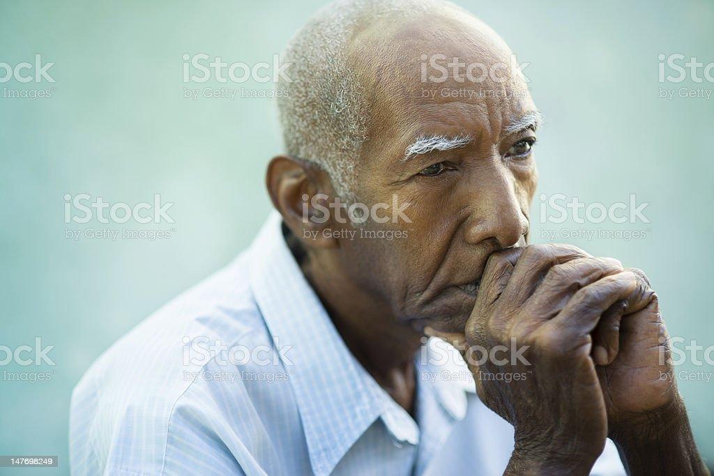 Portrait of sad bald senior man stock photo