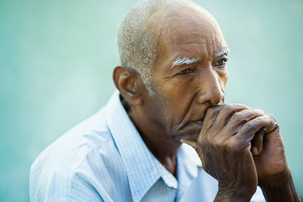 Portrait of sad bald senior man Seniors portrait of contemplative old african american man looking away. Copy space one senior man only stock pictures, royalty-free photos & images