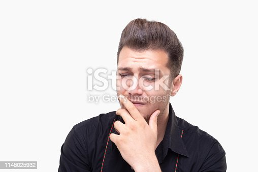 1162960006istockphoto Portrait of sad young man looking away with exhausted facial expression over white background 1148025932