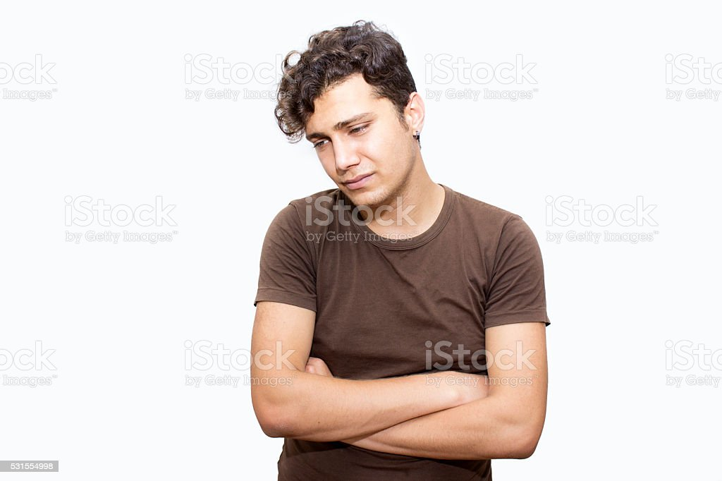 Portrait of sad young man over colored background stock photo