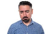 istock Portrait of sadness man wearing blue shirt 1205744830