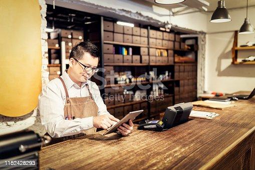 istock Portrait of Salesman at the cash desk 1152428293