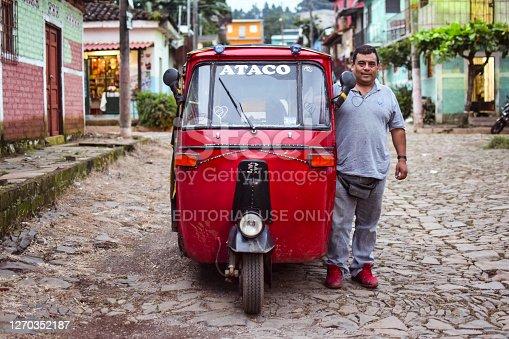 Concepcion de Ataco / El Salvador - October 29, 2017: portrait of salvadoran man driver of red rickshaw in touristy town