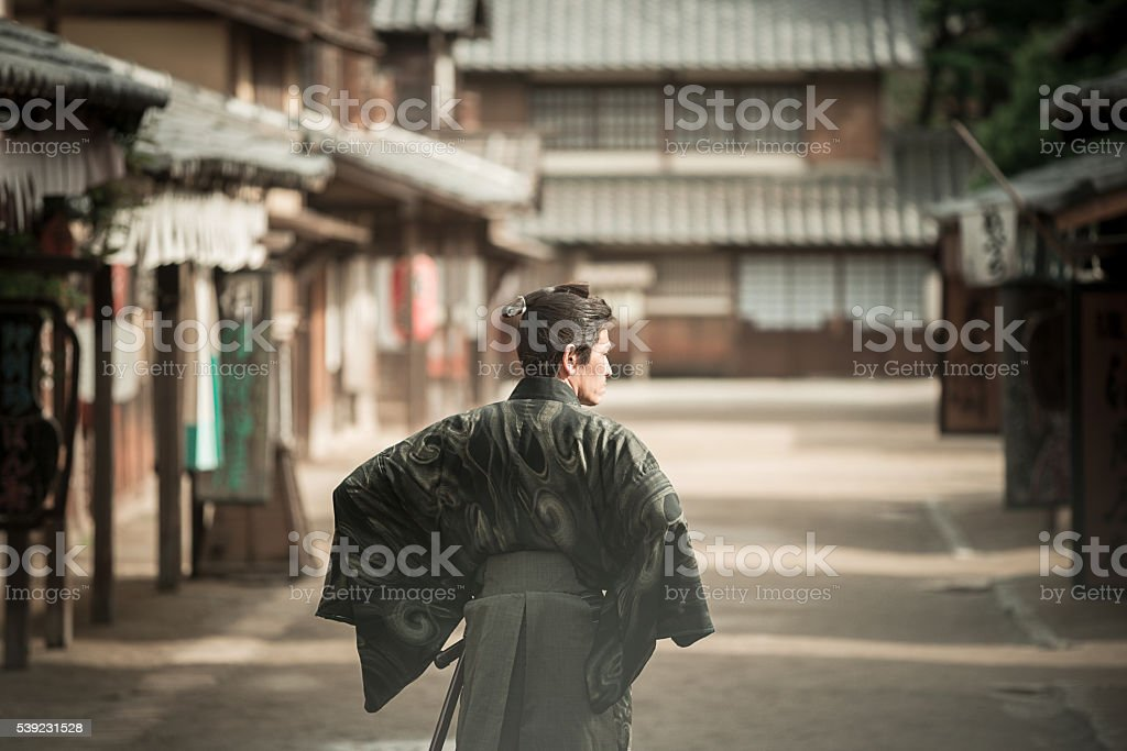 Portrait of samurai in traditional Japanese village royalty-free stock photo