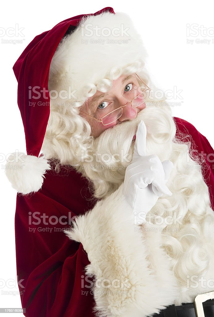 Portrait Of Santa Claus Making Silence Gesture royalty-free stock photo