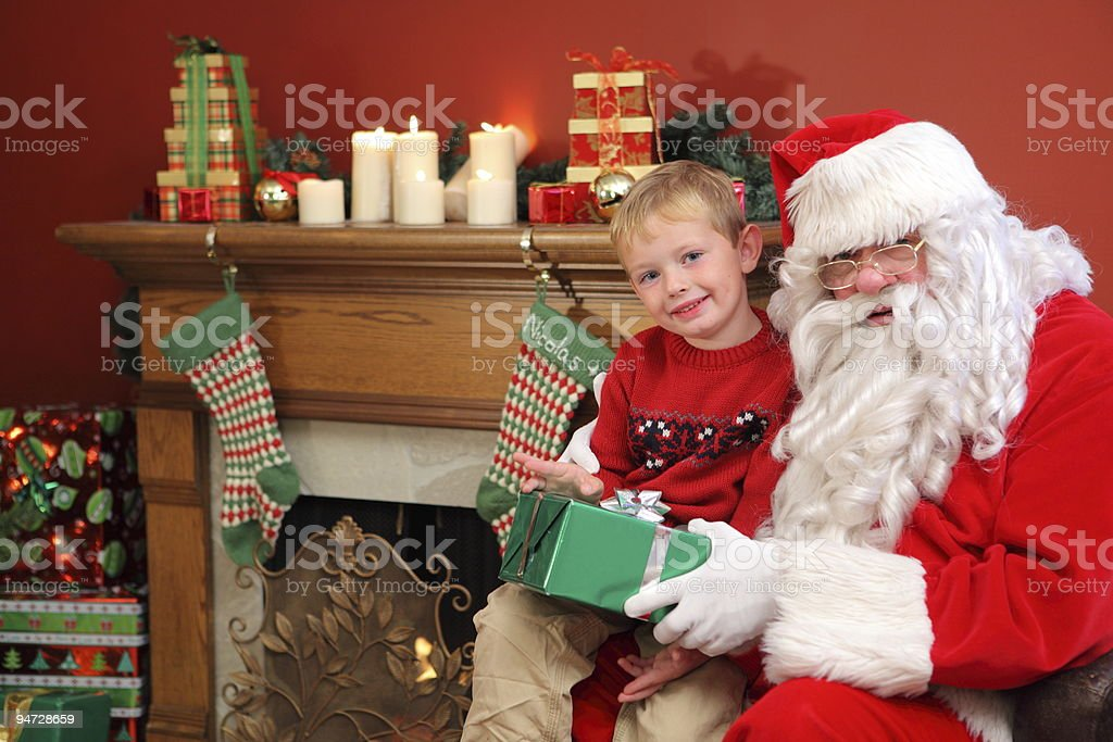 Portrait of Santa Claus with young boy royalty-free stock photo