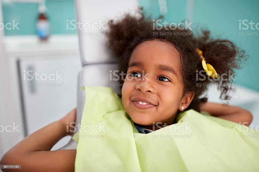 Portrait of satisfied child after dental treatment stock photo