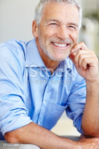 istock Portrait of satisfied mature business man smiling 121201050