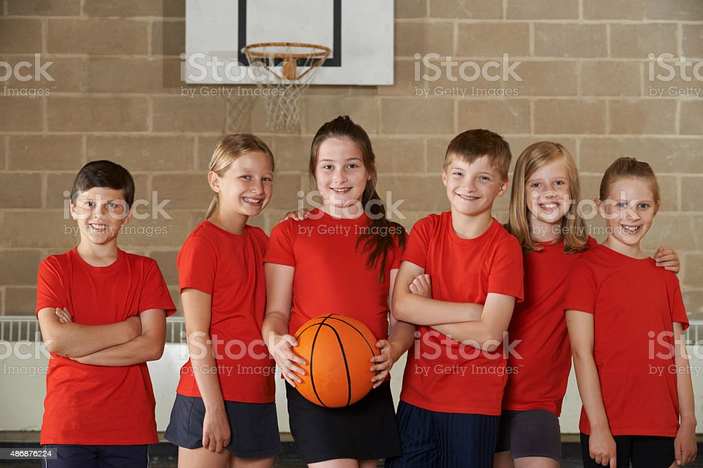 Portrait Of School Basketball Team In Gym stock photo
