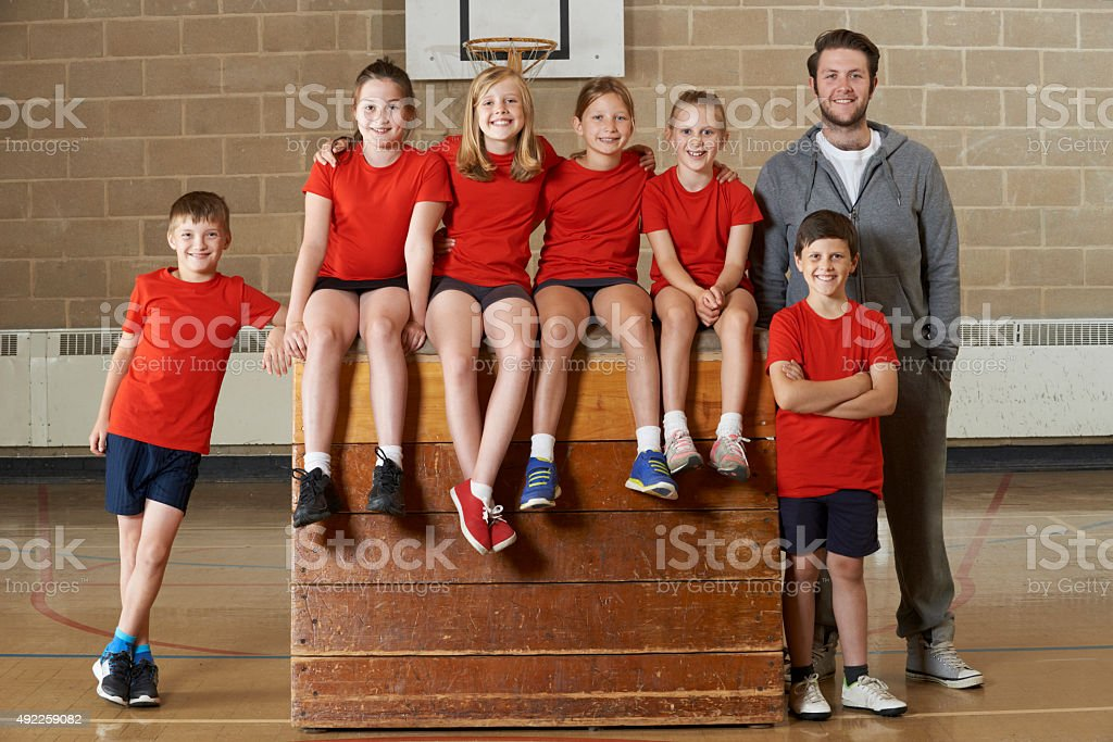 Portrait Of School Gym Team Sitting On Vaulting Horse stock photo