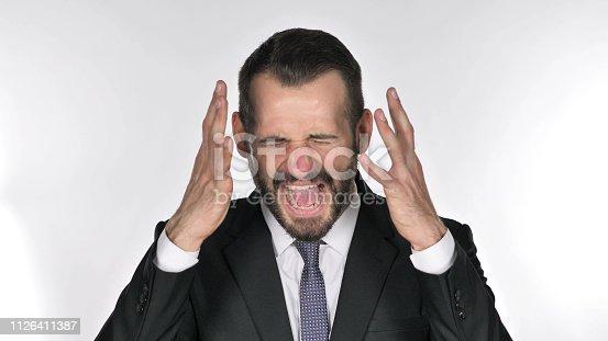 626964348istockphoto Portrait of Screaming Beard Businessman going Crazy 1126411387