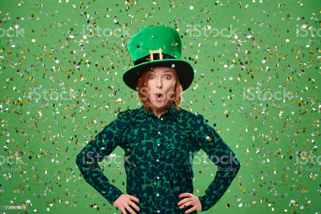Portrait of screaming leprechaun under a shower of confetti stock photo