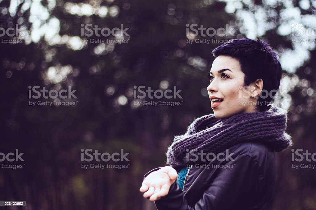 Portrait of seductive pretty girl with a tomboy hairstyle stock photo