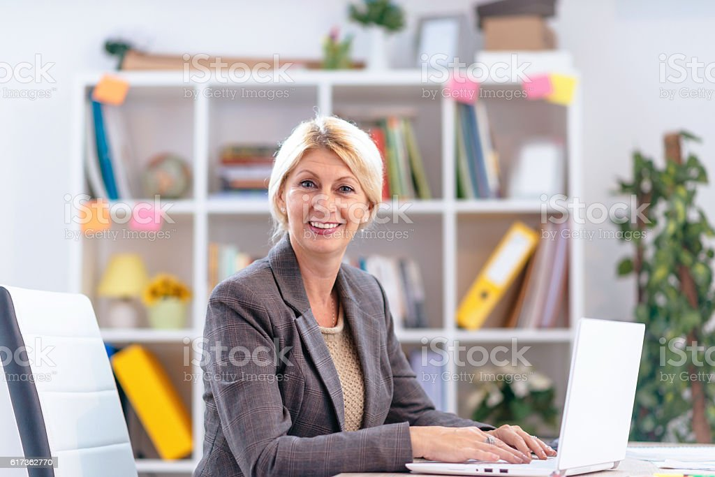 Portrait of self-esteemed Scandinavian businesswoman in office stock photo