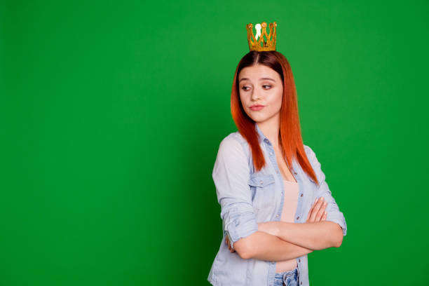 Portrait of selfish independent lady youth independent despise people person anger angry pride herself wear jeans outfit long straight hair isolated on green background Portrait of selfish independent lady youth independent despise people person anger angry pride herself wear jeans outfit long straight hair isolated on green background. arrogant stock pictures, royalty-free photos & images