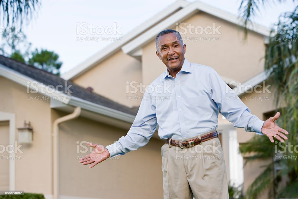 Portrait of senior African American man standing outside house stock photo