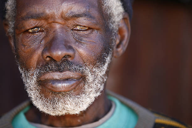 Portrait of Senior African Man Close up portrait of an aged, grey haired African man, from rural South Africa. Photo has a shallow depth of field. transvaal province stock pictures, royalty-free photos & images