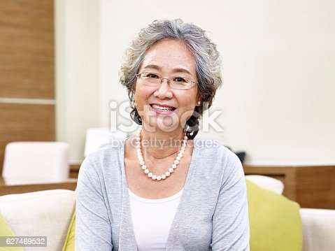 istock portrait of senior asian woman 627469532