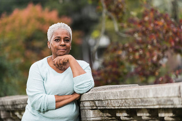 Portrait of senior black woman at the park stock photo