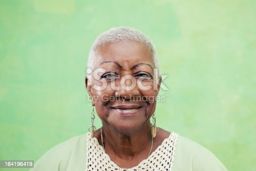 istock Portrait of senior black woman smiling at camera 164196419