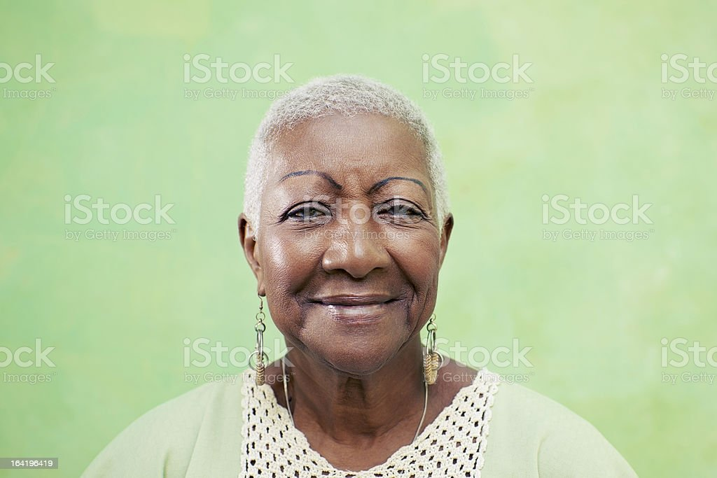 Portrait of senior black woman smiling at camera stock photo