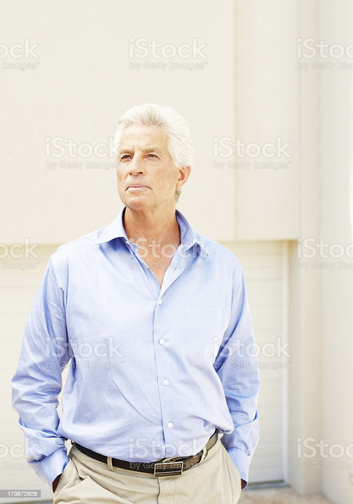 Portrait of senior business man looking away royalty-free stock photo