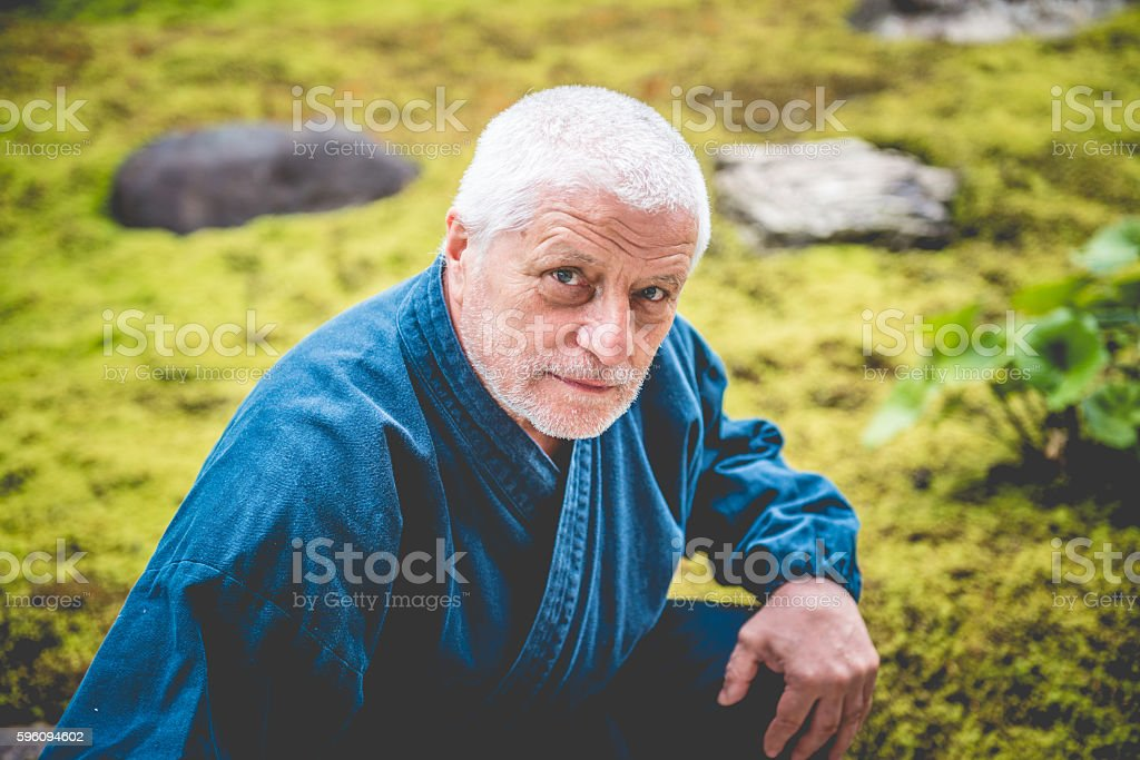 Portrait of Senior Caucasian Man in Buddhist Temple, Kyoto, Japan royalty-free stock photo