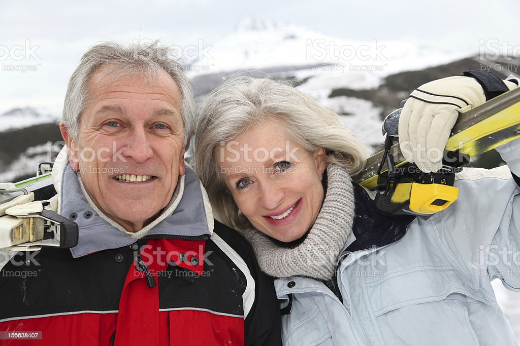 Portrait of senior couple at the mountain royalty-free stock photo