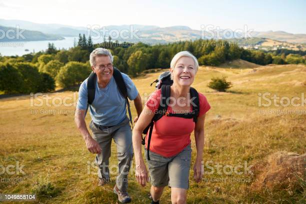 Portrait of senior couple climbing hill on hike through countryside picture id1049858104?b=1&k=6&m=1049858104&s=612x612&h=4vfok0srjld  1nb93iwdqiwhytmhyecpd8uoz0dfse=