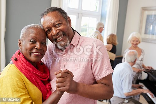 istock Portrait Of Senior Couple Enjoying Dancing Club Together 874803464