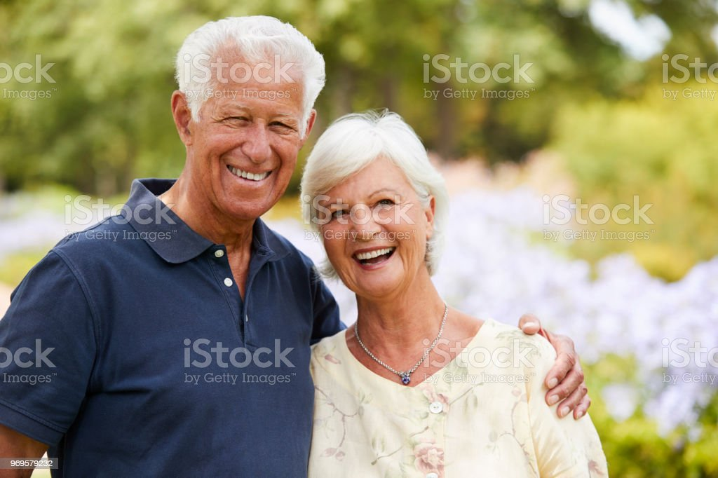 Portrait Of Senior Couple Enjoying Walk In Park Together стоковое фото