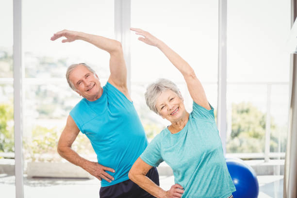 Portrait of senior couple exercising stock photo