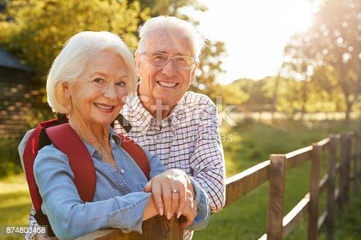 istock Portrait Of Senior Couple Hiking In Countryside Together 874803458