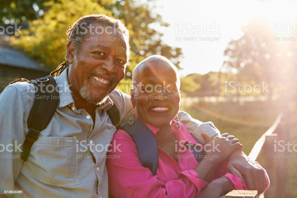 Portrait Of Senior Couple Hiking In Countryside Together stock photo