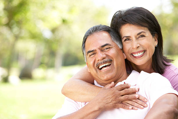 Portrait Of Senior Couple In Park  latin american and hispanic ethnicity stock pictures, royalty-free photos & images