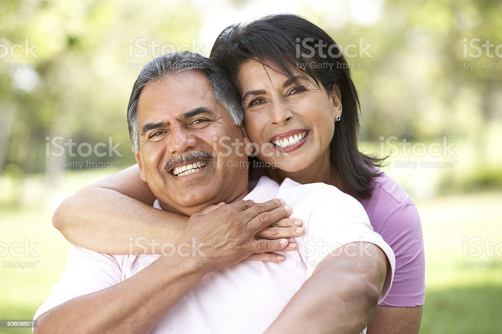 Portrait Of Senior Couple In Park stock photo