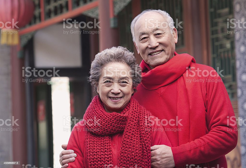 Portrait of Senior Couple outside by a traditional Chinese building stock photo