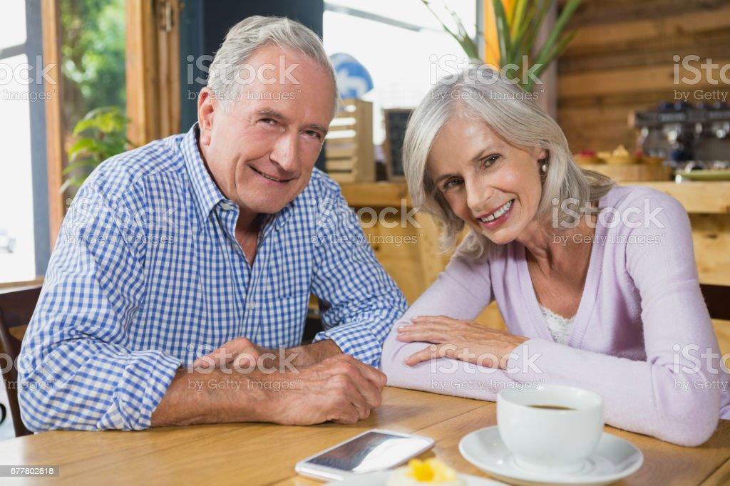 Portrait of senior couple sitting in café royalty-free stock photo