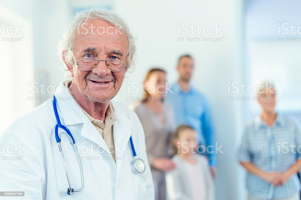 Portrait of senior doctor stock photo