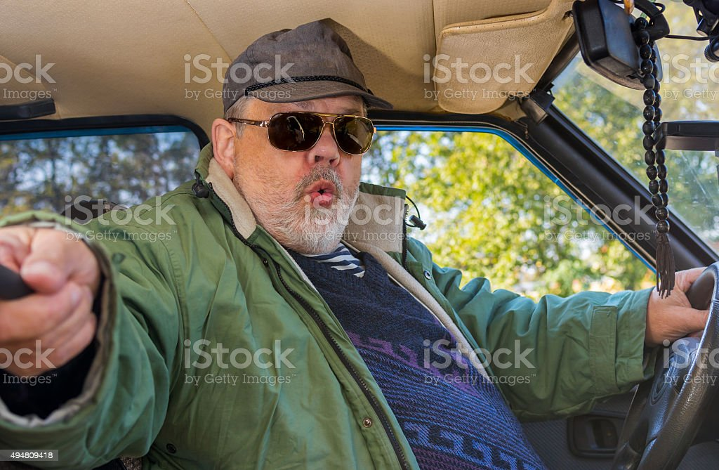 Portrait of senior driver making popular selfie in a car stock photo