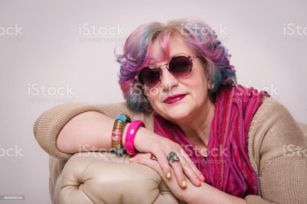 Portrait of senior elegant extravagant woman at home interior. - Photo