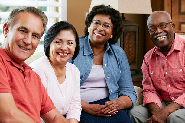 portrait of senior friends at home together - elderly group stock photos and pictures