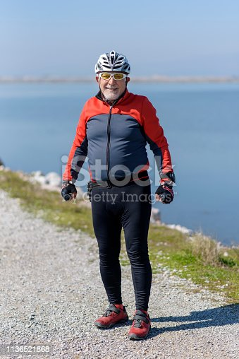 1029243348 istock photo Portrait Of Senior Male Cyclist 1136521868