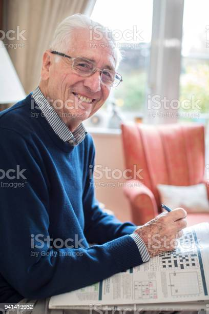 Portrait of senior man doing crossword puzzle at home picture id941419932?b=1&k=6&m=941419932&s=612x612&h=d6qtpteq0n5zufsr4 rviw4jn4kxcbyyob3 d2okbaw=