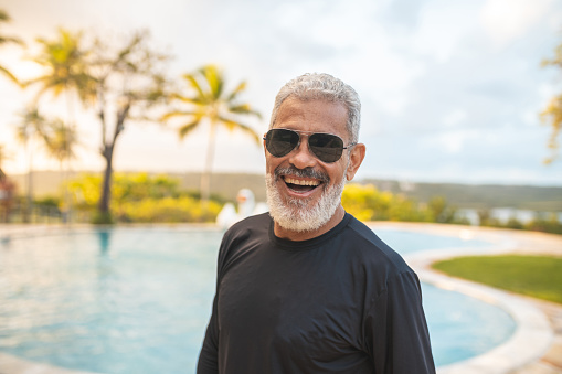 Portrait of senior man enjoying the summer